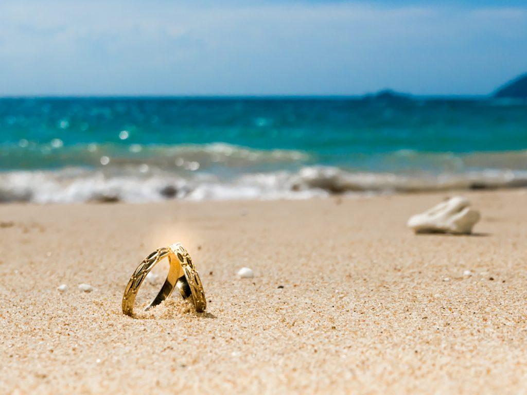 honeymoon on tropical island two wedding rings on the
