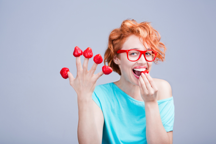 Woman Eating Stawberries From Fingers