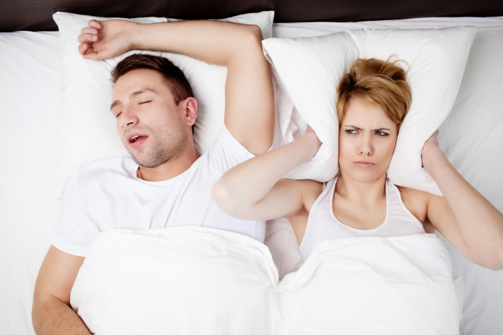 Couple in Bed Sleeping Disorder