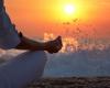 Woman meditating watching sunset